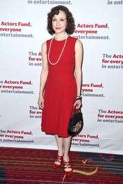 Bebe Neuwirth completed her retro-inspired ensemble with a floral-embroidered satin purse.