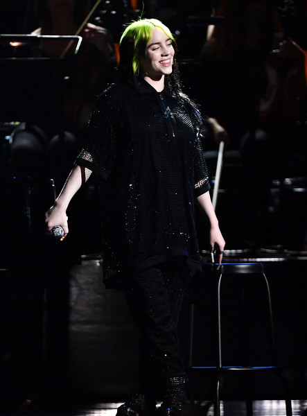 Billie Eilish performed at the 2020 BRIT Awards wearing an oversized black mesh polo shirt and matching pants.