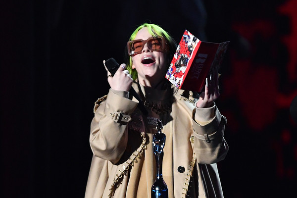 Billie Eilish spoke onstage at the 2020 BRIT Awards wearing cool square shades.