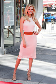 Kelly Rohrbach styled her simple frock with a pair of studded gladiator heels.