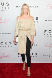 Lindsay Ellingson layered black skinny jeans under her dress for a more interesting finish.