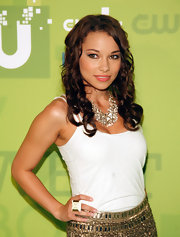 Jessica Parker Kennedy wore a statement necklace featuring pearls and crystals at the CW Network's 2011 Upfront event.