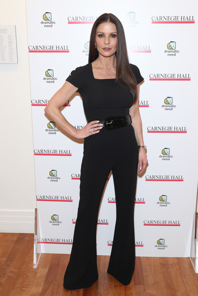 Catherine Zeta-Jones sheathed her slim figure in a fitted black jumpsuit for the Children's Monologues event.