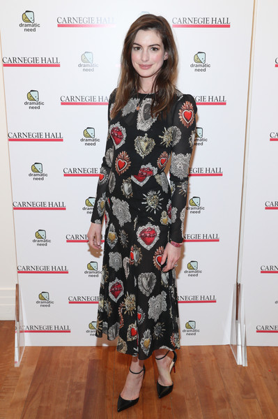Anne Hathaway kept it ladylike in a heart-print midi dress by Dolce & Gabbana at the Children's Monologues event.