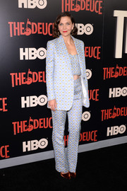Maggie Gyllenhaal looked playfully chic in a blue jacquard jacket, pants, and crop-top set by Miu Miu at the New York premiere of 'The Deuce.'