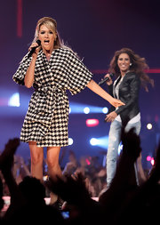 Mandy wears a retro houndstooth coat for her performance.