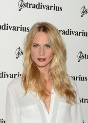 Poppy Delevingne stuck to her usual wavy hairstyle for 'The Event Paper' party.