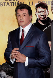 Sylvester Stallone paired his navy suit with a maroon solid tie.