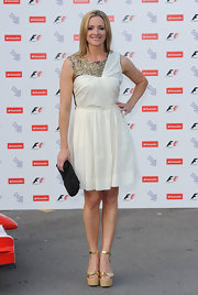 Gabby showed off her beaded white cocktail dress while attending the F1 party.