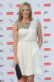 Gabby walked the red carpet in a flowing white cocktail dress with a metallic inset.