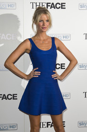 Caroline Winberg showed off her supermodel figure in a sexy blue bandage dress during the launch of 'The Face.'