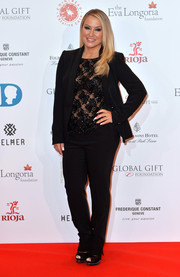Anastacia paired a black pantsuit with a sheer, beaded blouse for her Global Gift Gala look.