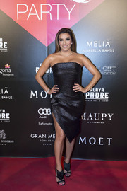 Eva Longoria was sexy-glam at the Global Gift party in a strapless LBD with an angular hem and a high slit.