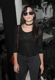 Daisy Lowe accessorized with a pair of round shades at the launch of The Heist.