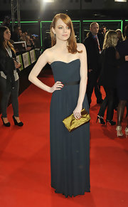 At 'The Help' premiere in Germany, Emma Stone paired her gorgeous draped frock with a mustard satin clutch with gold hardware.