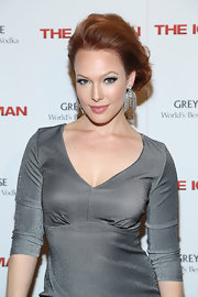 Erin Cummings showed off her fiery red locks with this teased updo.