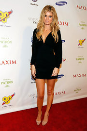 All it takes to show off Marisa's super model bod is a simple LBD with a plunging neckline and elongating nude pumps.