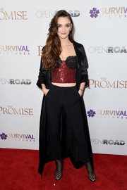 Charlotte Le Bon was showgirl-chic in a red and black sequin corset top by Rasario at the New York screening of 'The Promise.'