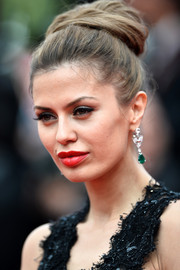 Victoria Bonya looked regal wearing her hair in a voluminous high bun during the premiere of 'The Search.'