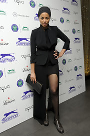 Ana Araujo went for modern elegance with this black skirt suit featuring a high-low hem at the 2012 Slazenger party.