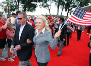 Natalie Gulbis looked quite professional in a gray single-breasted blazer on The Solheim Cup red carpet.