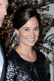 Pippa Middleton looked lovely in her prim and proper voluminous updo at the Sugarplum Ball.