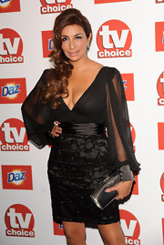 Shobna Gulati's swide-swept curls gave her an ultra-glam look at the 2011 TVChoice Awards in London.