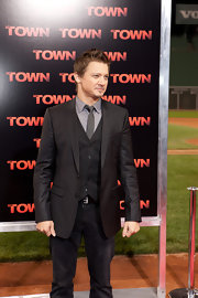 Jeremy Renner paired his classic blazer with a matching vest and dark denim. He offset his look with a grey skinny tie.