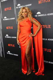 Mary J. Blige teamed her sexy dress with pointy gold pumps by Brian Atwood.