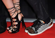 will.i.am's canvas shoes were totally edgy with the black and white striped design and gold studs.