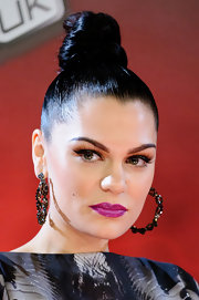 Jessie J. attend the launch of 'The Voice UK' wearing her glossy tresses in a tight top knot.