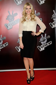 Holly Willoughby kept her red carpet look fairly simple with a black knee-length pencil skirt.