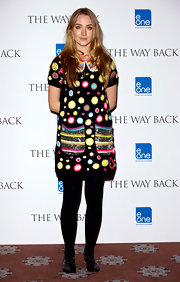 Saoirse paired a bold multicolored shift dress with black patent Oxfords.