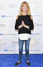 Goldie Hawn sealed off her laid-back look with a pair of black slip-ons.