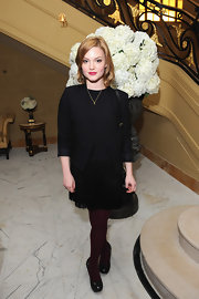 Holliday Grainger went classic wearing a fringed black dress at the Miu Miu event.
