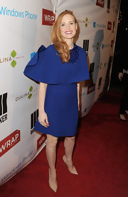 Jessica Chastain had a lot of fun at the pre-Oscar party wearing this caped royal blue number.