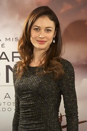 Olga Kurylenko showed off her long curls at the photocall for 'There Be Dragons.'