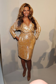 Beyonce attended Theyshens' Theory spring 2012 fashion show wearing a gold sequined wrap dress and nude leather heels.