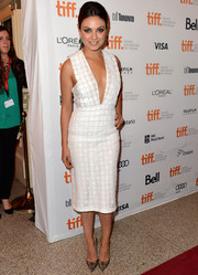 Mila Kunis paired snakeskin pumps with her low-cut dress for a totally fierce look.