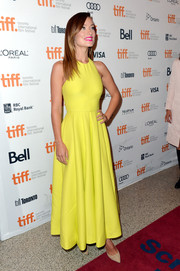 Olivia Wilde looked radiant in a bright yellow Valentino halter dress during the premiere of 'Third Person.'