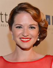 Sarah Drew wore her beautiful red hair in a chic chignon for this romantic look.