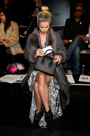 Nicky Hilton teamed Isabel Marant studded boots with a maxi dress and a suede coat for the Thomas Wylde fashion show.