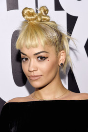 Rita Ora sported a super-funky knotted updo with blunt bangs during Fashion Rocks 2014.