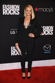 Miranda Lambert was androgynous-glam in a black pantsuit teamed with a bedazzled bra during Fashion Rocks 2014.