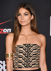 Lily Aldridge shone with layers of gold armlets during Fashion Rocks 2014.