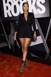 Nicki Minaj flaunted major cleavage and leg in a super-short Saint Laurent LBD during Fashion Rocks 2014.