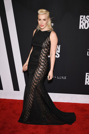 Natasha Bedingfield channeled her inner bombshell in a black gown with see-through panels down the sides during Fashion Rocks 2014.