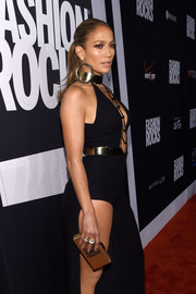Jennifer Lopez turned heads with this gold Thale Blanc box clutch and black Atelier Versace gown combo during Fashion Rocks 2014.