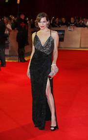 Milla Jovovich was a sultry vixen at 'The Three Musketeers' premiere in London. Milla opted for a glamorous glittering gown complete with a sexy neckling and thigh high split.