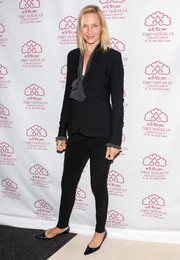 Uma Thurman opted for a basic black pantsuit when she attended the Tibet House benefit auction.